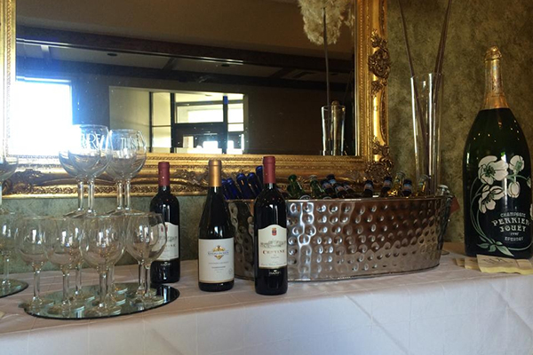 turf tavern banquet room wine and champagne bottles