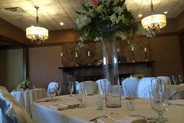 turf tavern banquet room tables set with large floral centerpiece