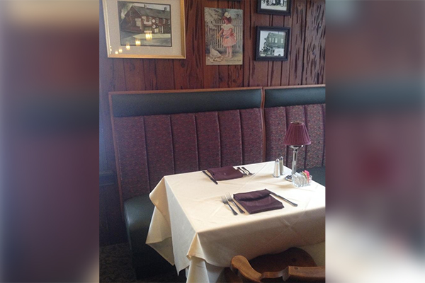 booth with burgundy napkins