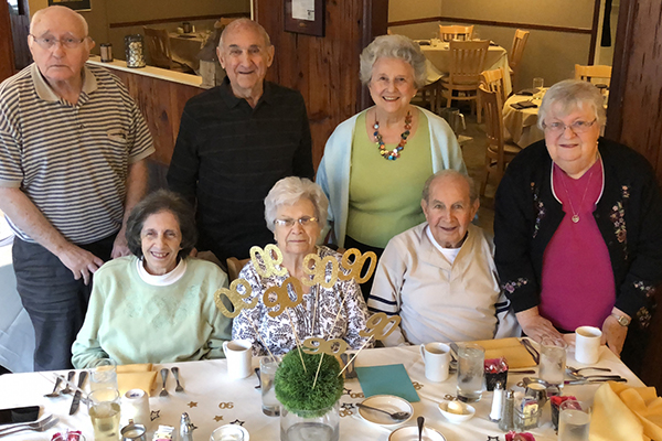 seven people celebrating a 90th birthday in the turf tavern restaurant