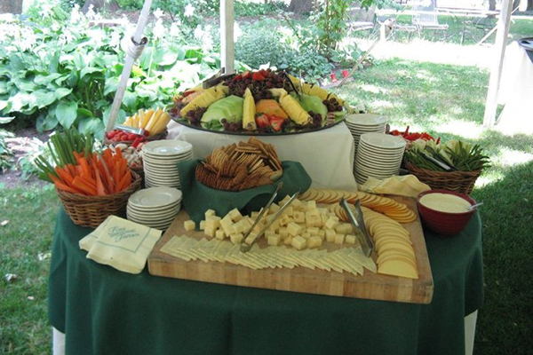buffet spread with cheeses and fruit