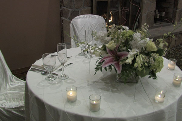 catering table with beautiful flowers and candles lit